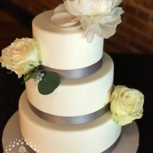 This beautifully simple cake was created by Sumthin' Sweet, using flowers from Schulz's Florist.  They both have our highest recommendations!