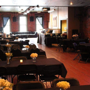 Wick's Pizza in New Albany Upstairs Party Room, flower arrangements done by Schulz's Florist
